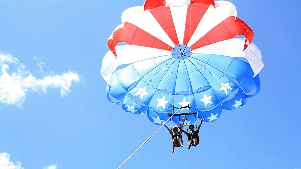 Show item 9 of 9. Friends on American flag parasail