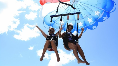 Friends on American flag parasail