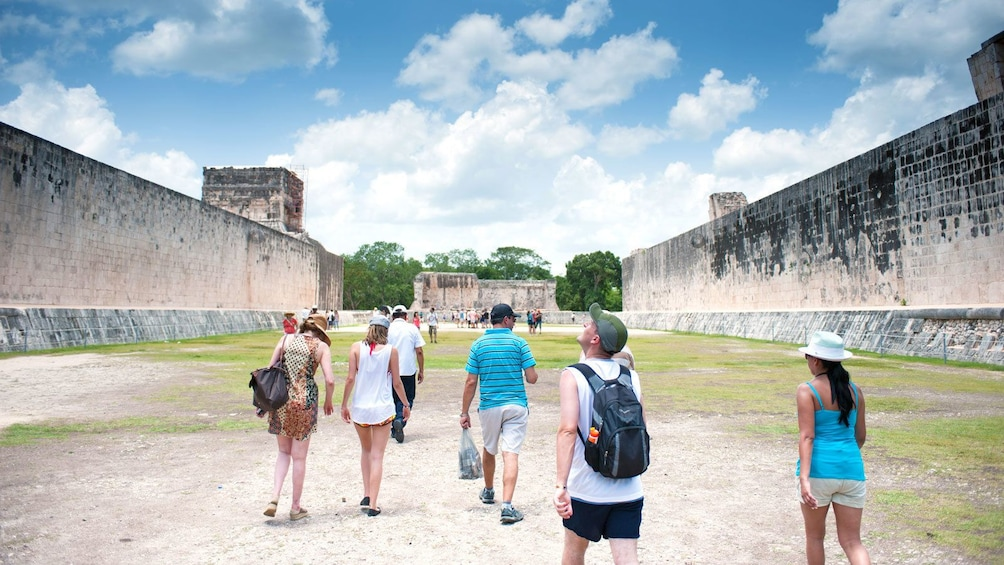 Show item 1 of 5. walking through the ancient structures in Chichen Itza