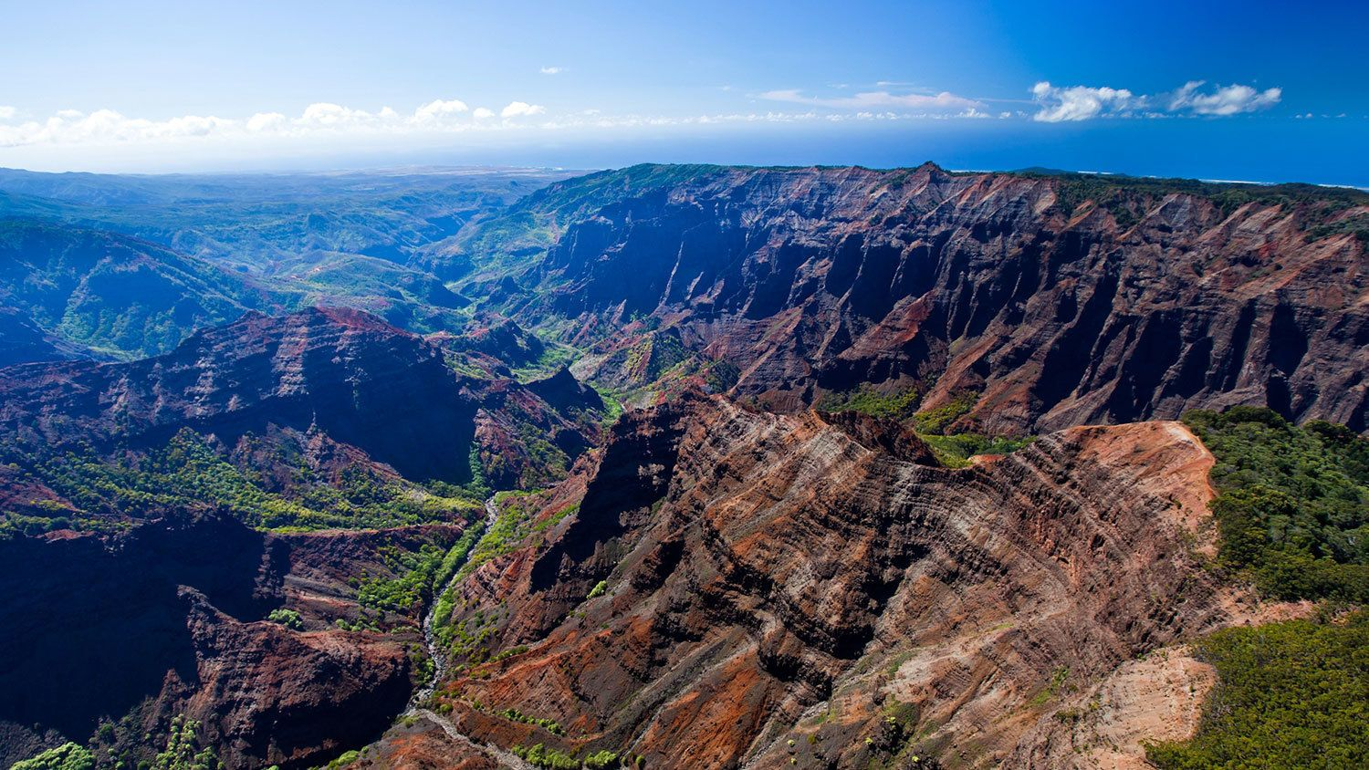 Ariel view of mountain range and valleys in Kauai