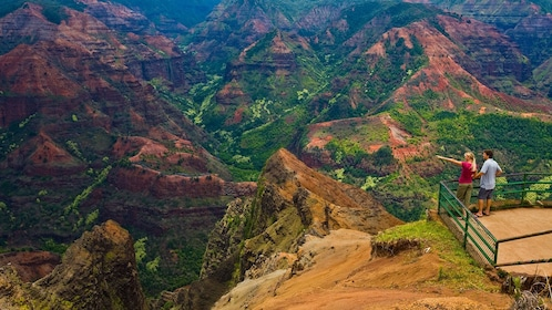 two people looking over landscape of Kauai