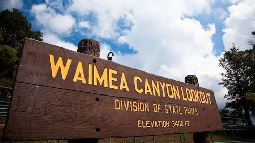wooden sign for Waimea Canyon Lookout in Kauai