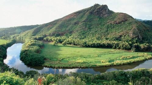 River snaking around mountain in Kauai