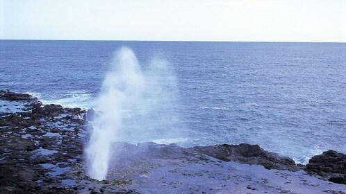 natural geyser on beach in Kauai
