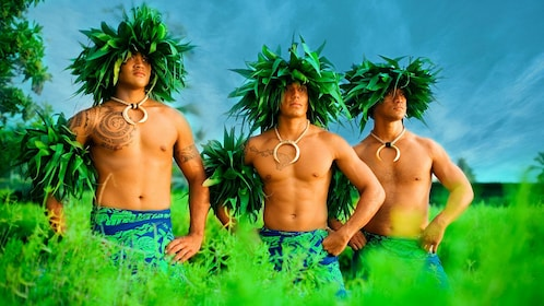 Three male performers in the Haleo luau on the Big Island of Hawaii