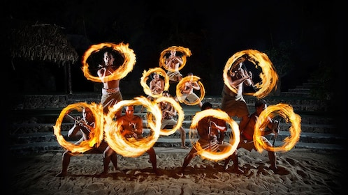 Fire dancers perform live onstage at the Polynesian Cultural Center