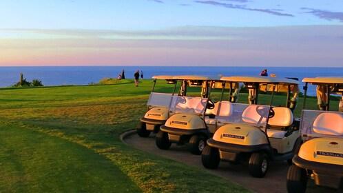 Parked golf carts at sunset on Kauai