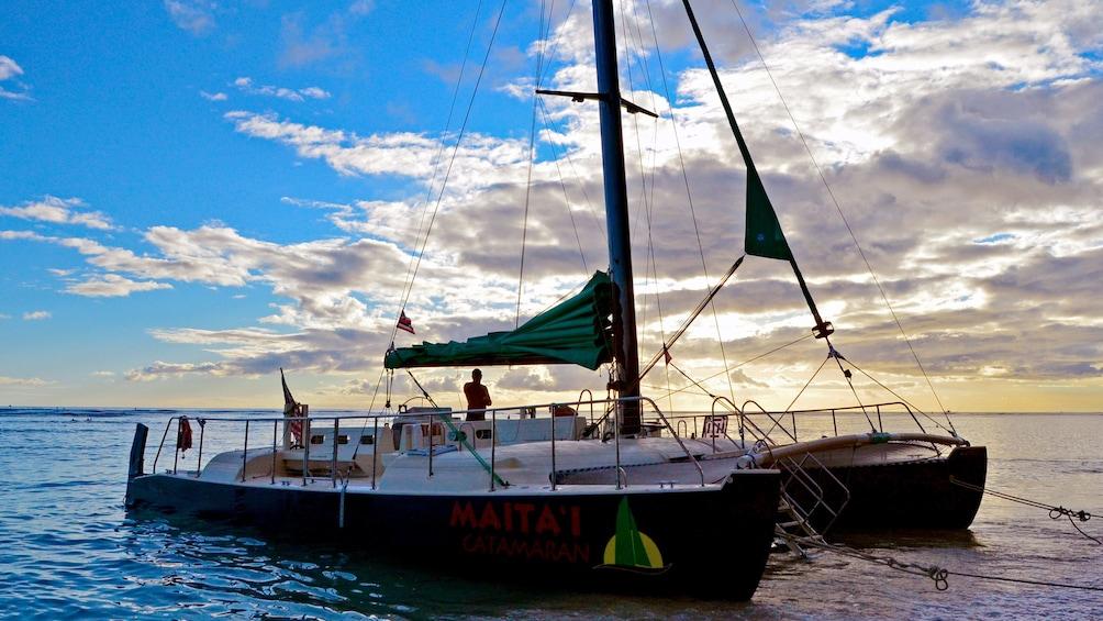 Show item 8 of 8. Catamaran at dusk in Oahu