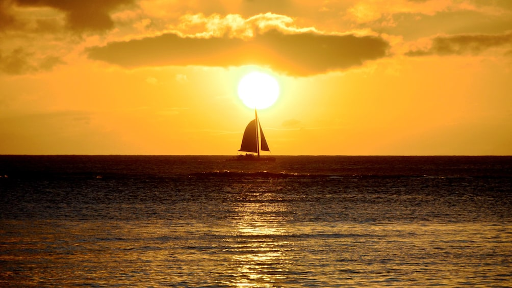 Show item 1 of 8. Sailboat at sunset in Oahu
