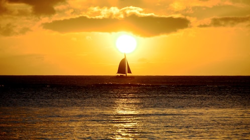 Sailboat at sunset in Oahu