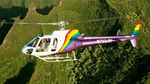 Close view of a helicopter flying above Kauai