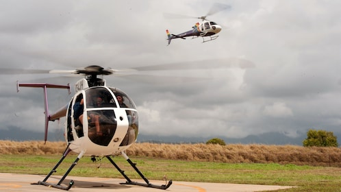 helicopters on landing pad in Kauai