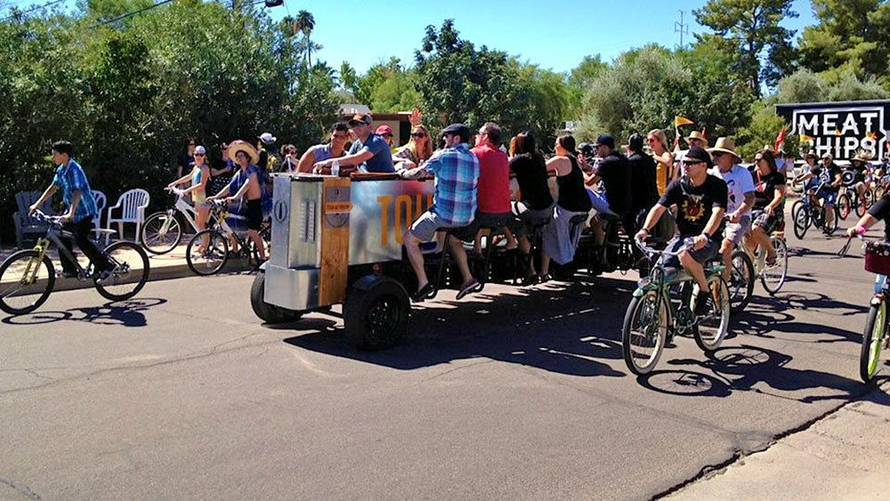 cyclists surrounding the party bike on the road in Phoenix