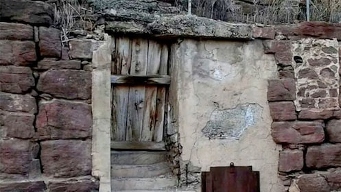 Side of a crumbling building in Jerome