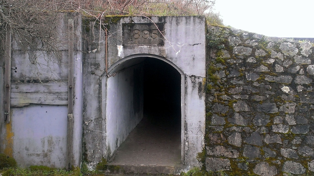 Show item 3 of 5. Entrance to a tunnel at Macaulay Point Park on Vancouver Island
