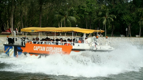 Amphibious bus splashing into the water in Singapore