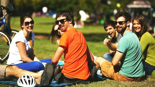 Bicycle tour group takes break on grass in Brisbane