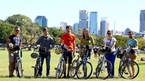 Bicycle tour group poses for photo before ride in Brisbane