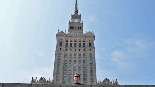man standing in front of tall tower