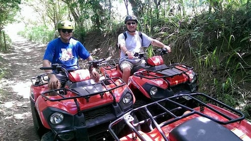 Two men enjoying an ATV adventure in St. Kitts and Nevis