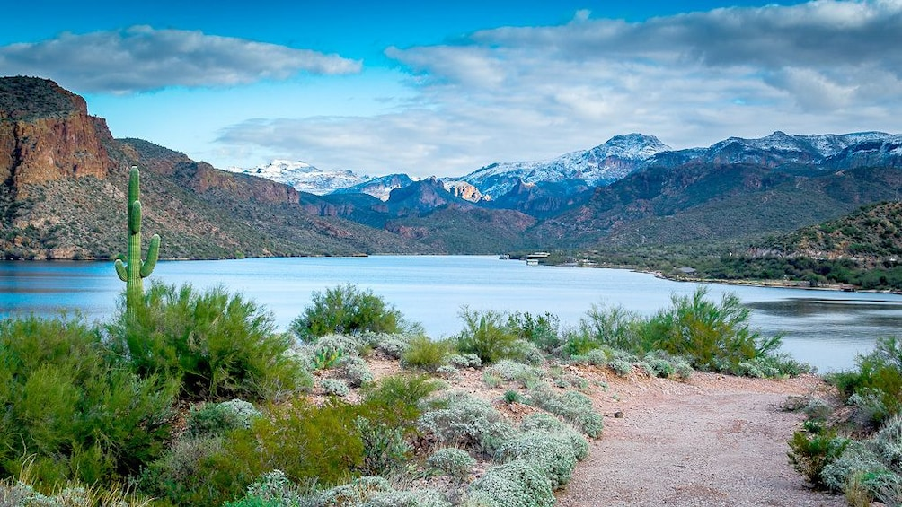 Show item 2 of 4. An Apache trail in Arizona on a lake