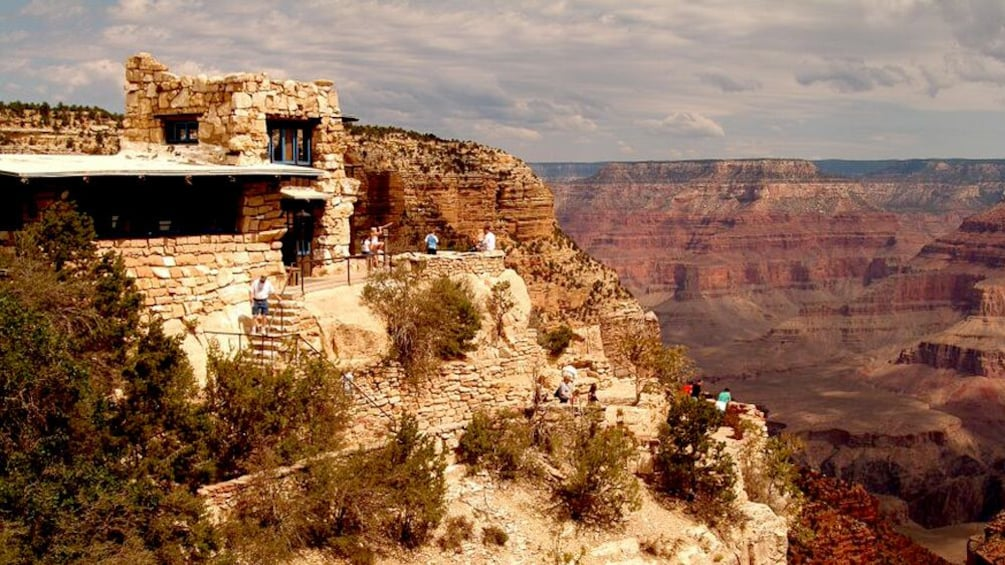 Show item 5 of 5. Stone observatory overlooking the Grand Canyon