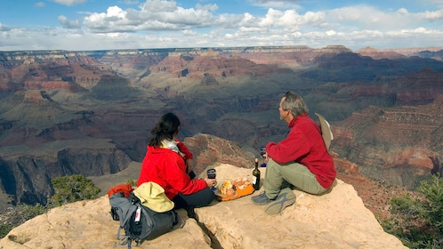 couple enjoying food and drink at vista over canyon