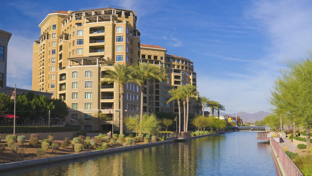 Show item 3 of 5. Angled view of city building in downtown Scottsdale.