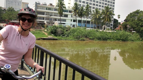 Woman on bicycle with city in the background in Chiang Mai