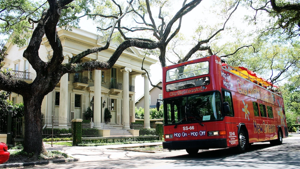 Show item 2 of 8. Hop-on hop-off bus outside a mansion in New Orleans