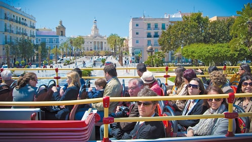 red double decked bus full of passengers in Cadiz