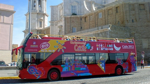 sightseeing in the city on a red double decked bus in Cadiz