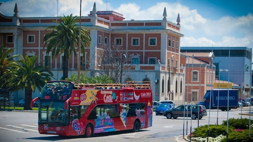 exploring the city on a red double decked bus in Cadiz