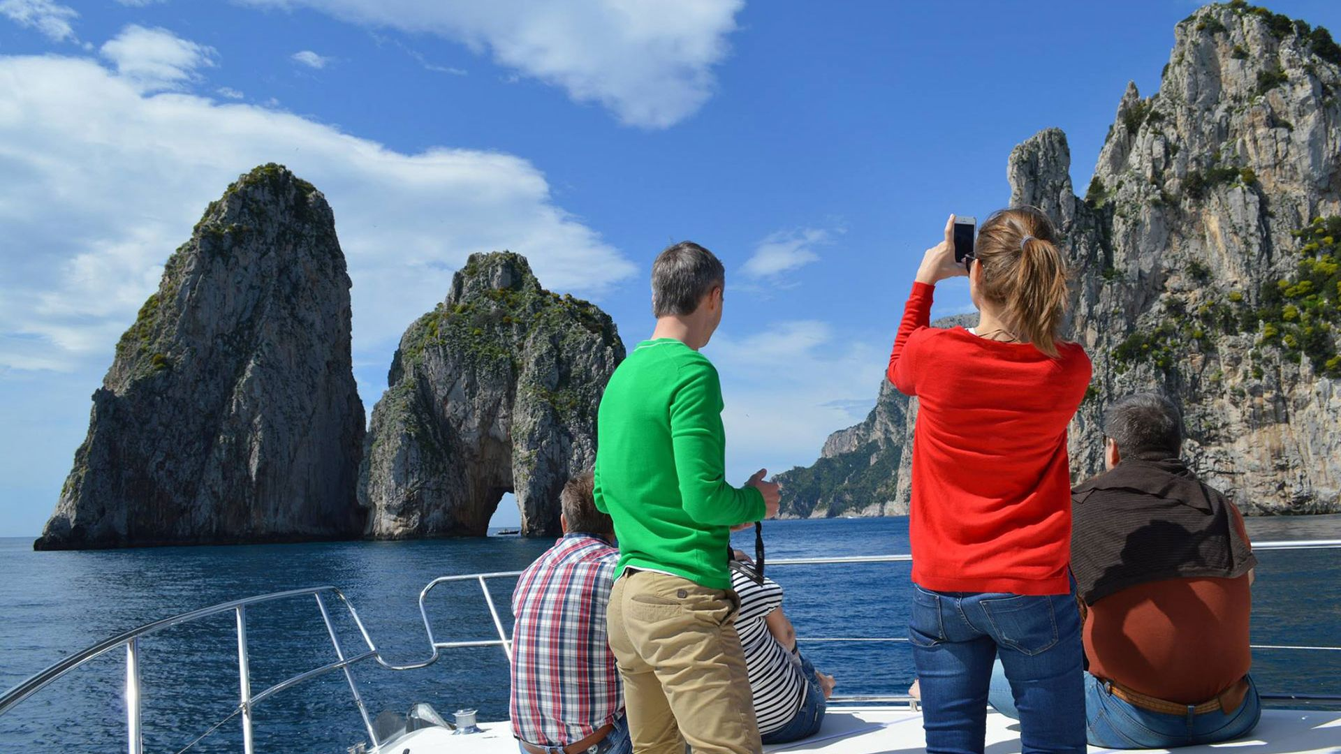 Family observing beautiful view of island from boat.