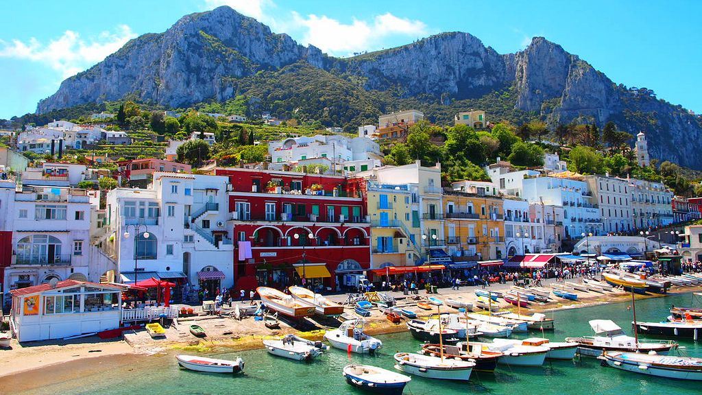 Boats clustered around beach of Capri Island