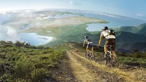 couple riding bikes down a steep mountain trail in Bangkok