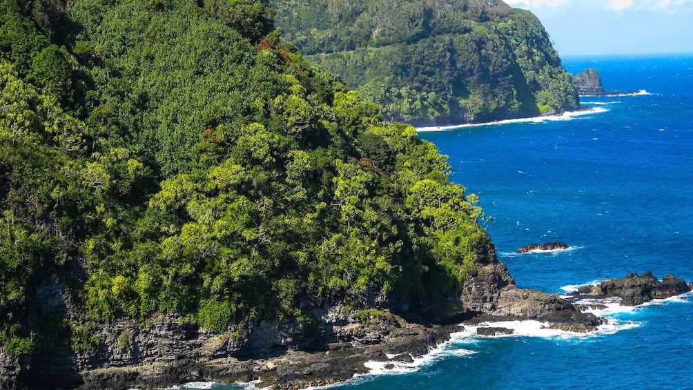 Show item 4 of 10. Rocky shore line on Maui