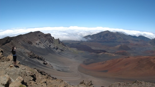 Woman taking photo at the Haleakala crater in Maui