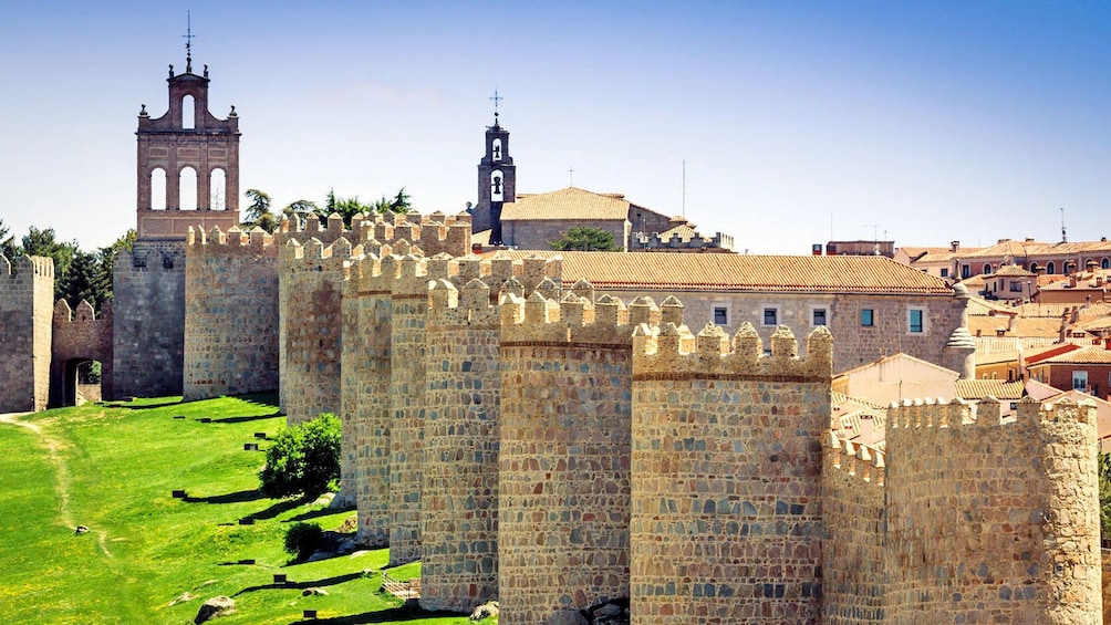 Show item 1 of 10. stone sentry towers along the castle walls in Spain