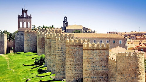 stone sentry towers along the castle walls in Spain