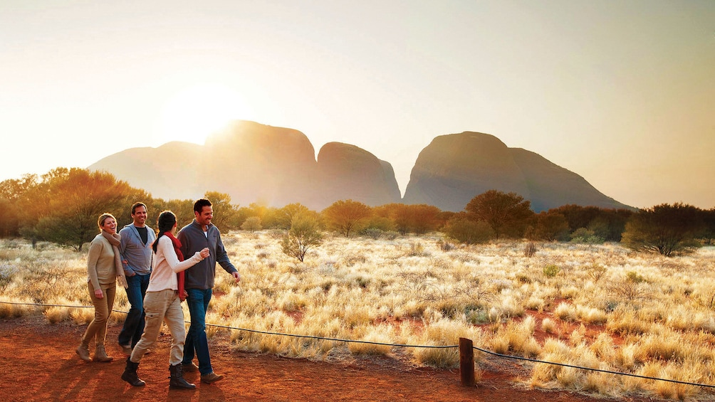 Two couples walking on a dirt path in the valley of the winds