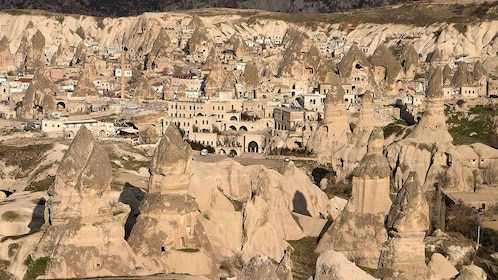 Buildings nestled in between rock formations in Goreme