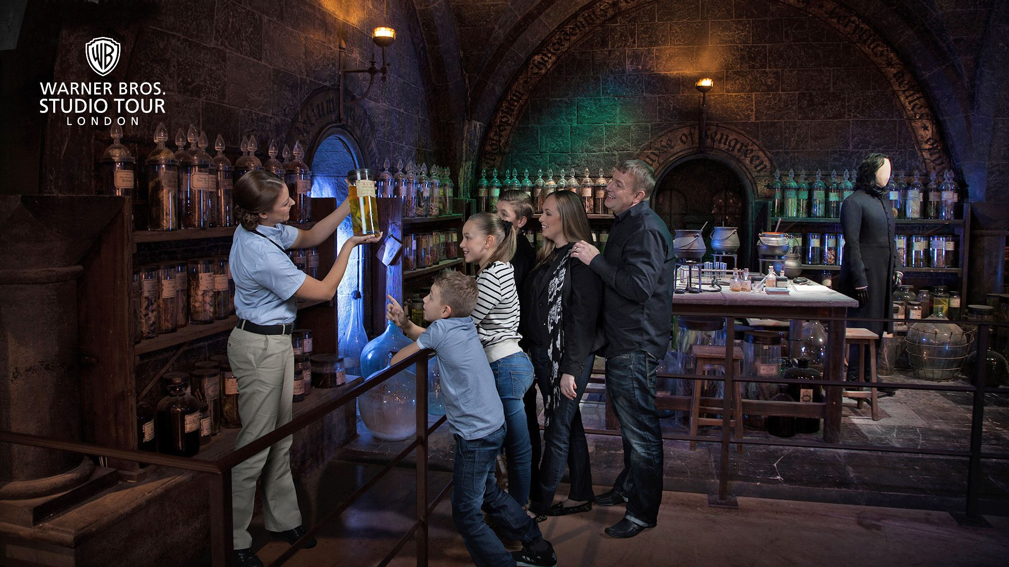 A tour guide takes a group through Snape's potion class in the Wizarding World of Harry Potter