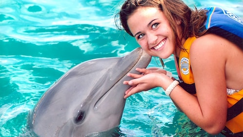 Woman kissing a dolphin