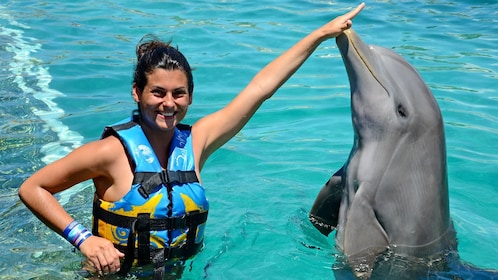 Woman enjoying the Dolphin Encounter in Anguilla
