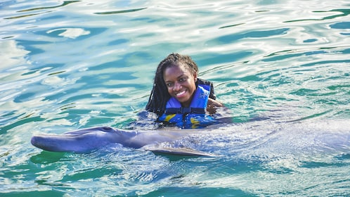 Woman swimming with dolphin at Dolphin Discovery in St. Kitts