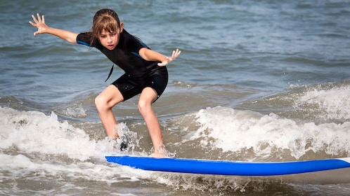 Young girl having fun on the surf lesson in Myrtle Beach, SC