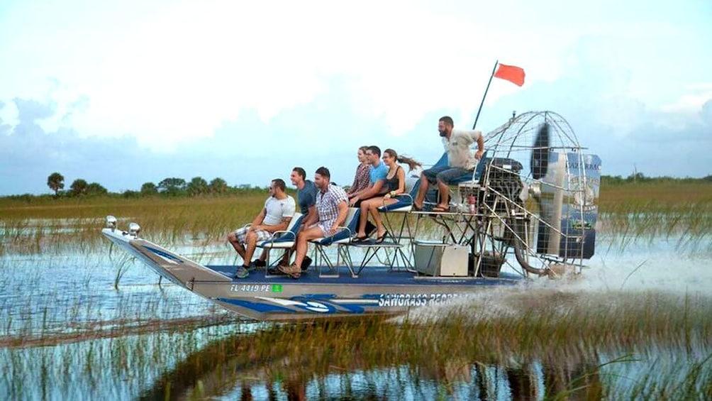 airboat speeding through the water in Florida