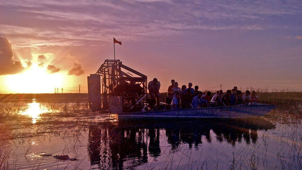Show item 1 of 9. airboat ride during the sunset in Florida