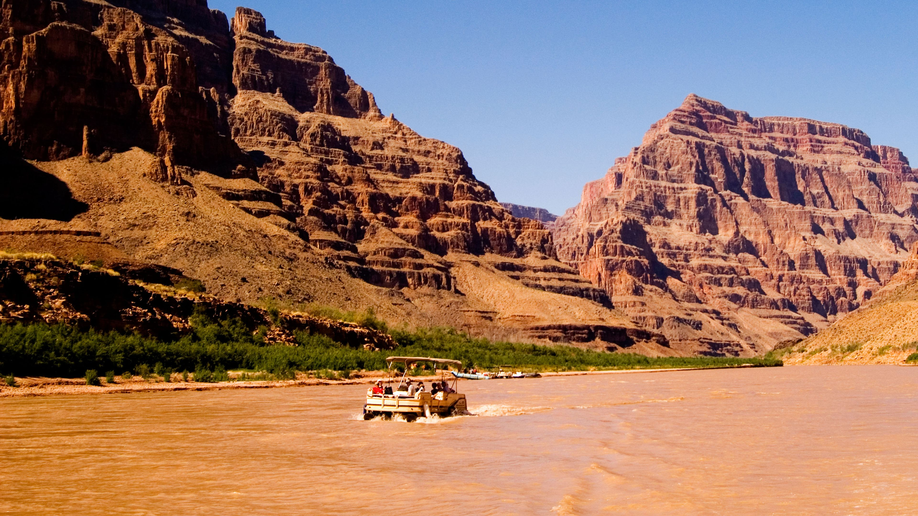 Scenic Grand Canyon Boat Trip Boating pontoon boat on Colorado River Arizona AZ